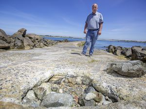 Picture By Peter Frankland. 15-06-21 Jr Constable Bill Cohou at Rousse Pier where a large hole has opened up. Local fishermen have filled the hole with rocks as a temporary fix.. (29659931)