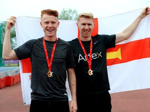 Always flying the flag for Guernsey: Alastair and Cameron Chalmers on past England Championships duty. (Picture by Mark Shearman)