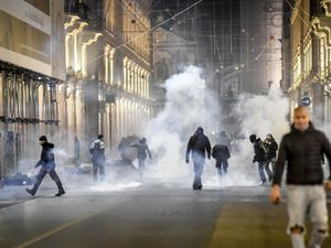 Protests in Italy over new virus crackdown turn violent