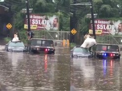 Watch police save newlyweds from rising flood water