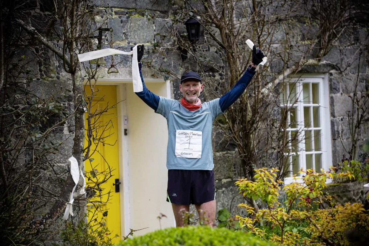 Graham Merfield completed a marathon in his garden by breaking a toilet roll finishing tape. (Pictures by Peter Frankland, 27770766)