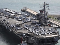 US Navy plane with 11 aboard crashes into Pacific on way to aircraft carrier