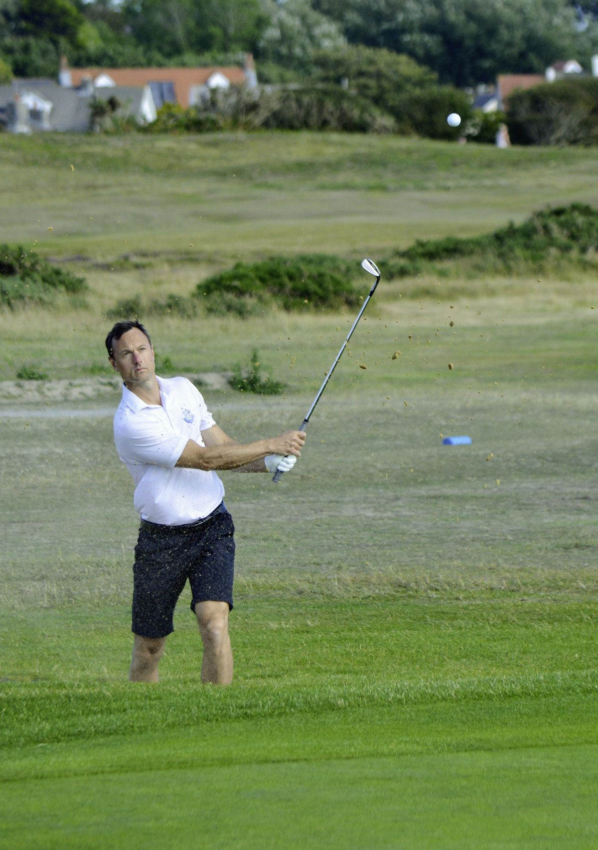 Danny Blondel splashes out of a bunker at the fourth. (Picture by Gareth Le Prevost, 28464555)
