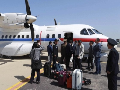Foreign media depart for North Korean nuclear site