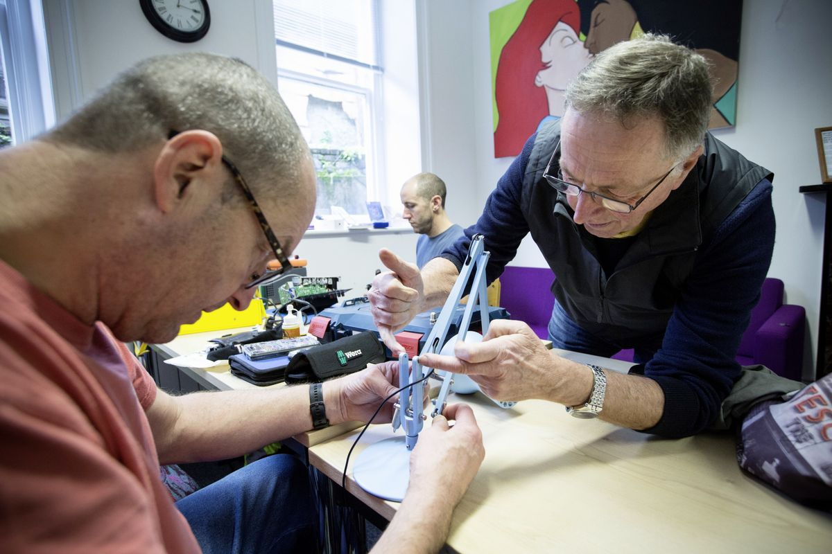 Clean Earth Trust volunteer Stef Bampton takes a look at the angle poise lamp with a faulty arm brought to the Repair Cafe drop-in by Tim R. Langlois. (Pictures by Adrian Miller, 29118830)