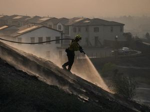 Tens of thousands evacuated as crews battle California wildfires