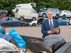 Closed hotel faces £5k bill to clear dumped cars