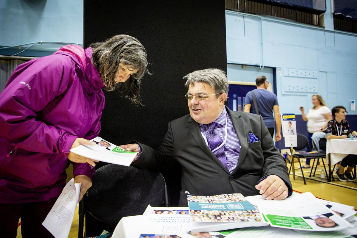 Current deputy, John Gollop, at yesterday's Meet the Candidates event at Beau Sejour, a drop-in with 116 of those who are standing in Guernsey's first island wide election. (Picture by Sophie Rabey, 28708657)