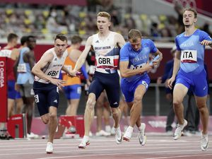 Great Britain's Joseph Brier (left) receives the baton from team-mate Cameron Chalmers during his leg of the Men's 4 x 400m Relay at the Olympic Stadium on the fourteenth day of the Tokyo 2020 Olympic Games in Japan. Picture date: Friday August 6, 2021...Picture PA Wire / PA Images. (30105408)