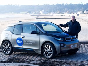 EVie is the name of the new on-demand electric car sharing scheme in Jersey. The company's Andrew Ruellan is seen with one of its vehicles. (Picture by Jon Guegan, 26972181)