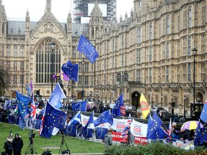 Anti- and pro-Brexit protesters fly flags outside the Houses of Parliament, (Picture by Yui Mok/PA Wire)