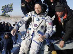 Space capsule with three astronauts returns safely to Earth