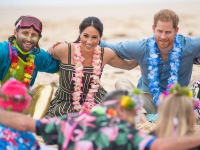 Pregnant Meghan hails 'healing' power of yoga as royal couple visit Bondi Beach