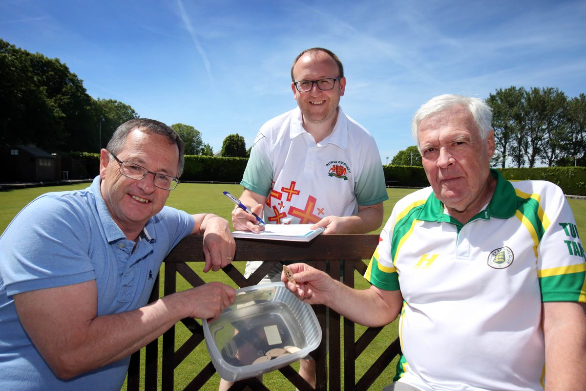 At his beloved Beau Sejour green Joe Thompson makes the draw for the Rothschilds Open Bowls event which he sponsored heavily. Also pictured are Rob Batiste, Thompson's predecessor as Bowls Guernbsey president, and secretary Garry Collins. (27926863)