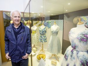 National Trust of Guernsey president Tony Spruce with part of the new exhibition at the Folk and Costume Museum. (Picture by Adrian Miller, 29411090)