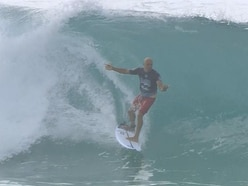 Watch: Surfer Kelly Slater somehow gets back on his board after falling mid-barrel