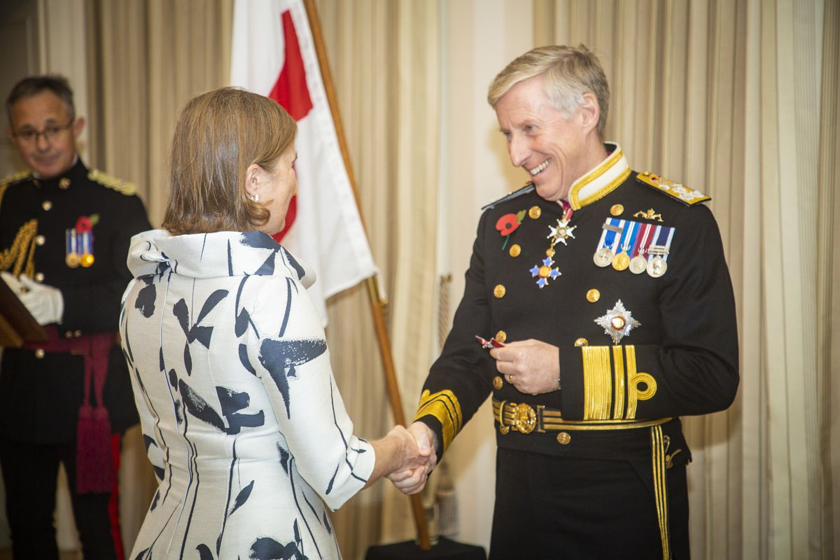 One of the Lt-Governor's roles is to hold investitures in the island. In this case, Vice Admiral Sir Ian Corder presents the British Empire Medal to Elizabeth Hutchinson, the head of the Schools' Library Service. (Picture by Sophie Rabey, 29504747)