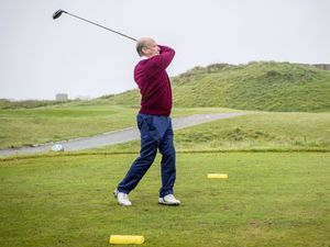 By Royal appointment: Royal Guernsey Golf Club captain Peter Radford drives off the first tee at L'Ancresse yesterday when he was one of the members making the most of the opportunity to return to action, albeit with strict measures in place due to the coronavirus pandemic.    (Picture by Sophie Rabey, 28238285)