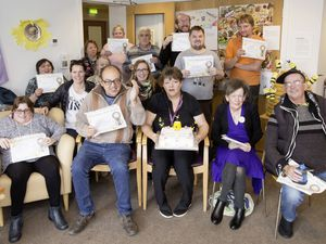 The Busy Bees group of adults with learning difficulties received certificates for their arts and crafts projects which were carried out during lockdown with the help and support of outreach support worker Viv Torode, front row, centre. (Pictures by Adrian Miller, 28829321)