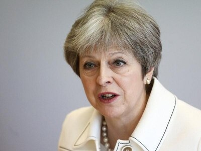 Theresa May vows action on upskirting after Tory MP blocks Bill