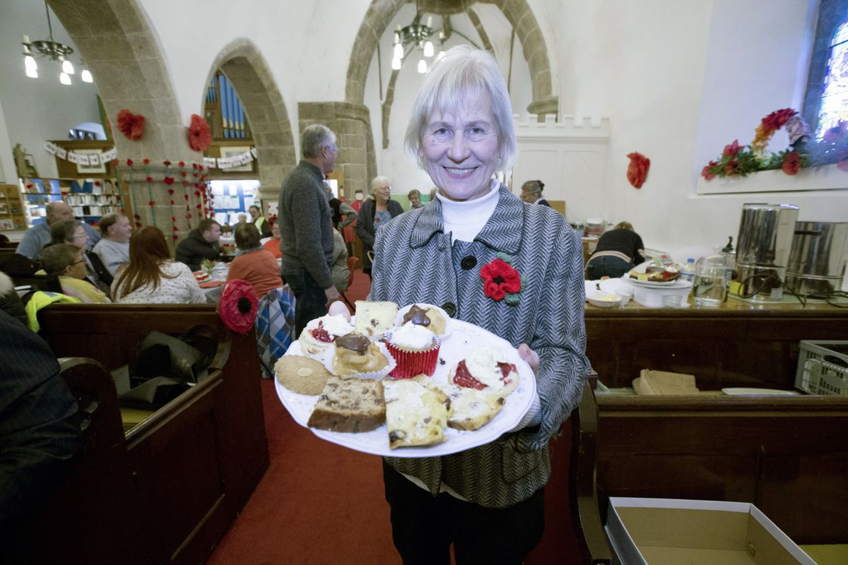 St Saviour's Church Remembrance tea party. Margaret Martel offers cakes. (Picture by Adrian Miller, 28881676)
