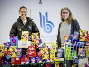 Picture by Sophie Rabey.  26-03-21.  Les Beaucamps High School have been collecting Easter Eggs for Guernsey Welfare Service.  L-R Assistant Headteacher Tracy Hubert and Guernsey Welfare Sue Le Friec, with all of the eggs collected for charity.. (29376504)