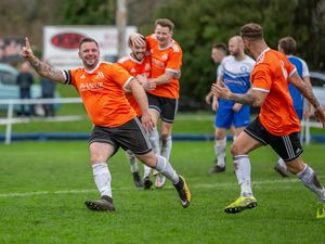 Happier times for Manzur: Craig Young celebrates a goal which sunk the FNB Priaulx League leaders at The Track.