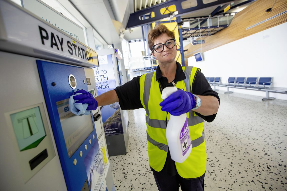 Ana Pirouet, who has worked for G4S for 18 years, was busy cleaning and disinfecting the airport yesterday with more arrivals due from today as travel rules change. (Picture by Peter Frankland, 29711993)