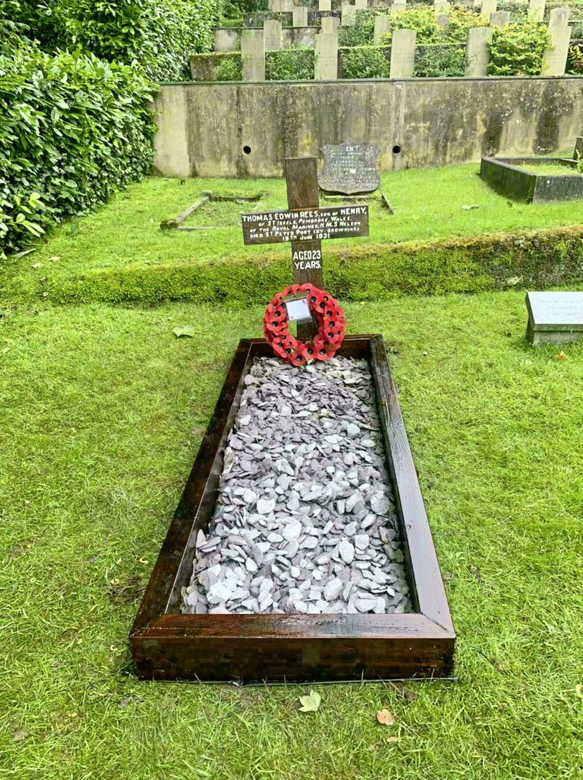 The inscription on the cross has been repainted and the grave marked with blue slate. A poppy wreath was laid during Saturday's ceremony.