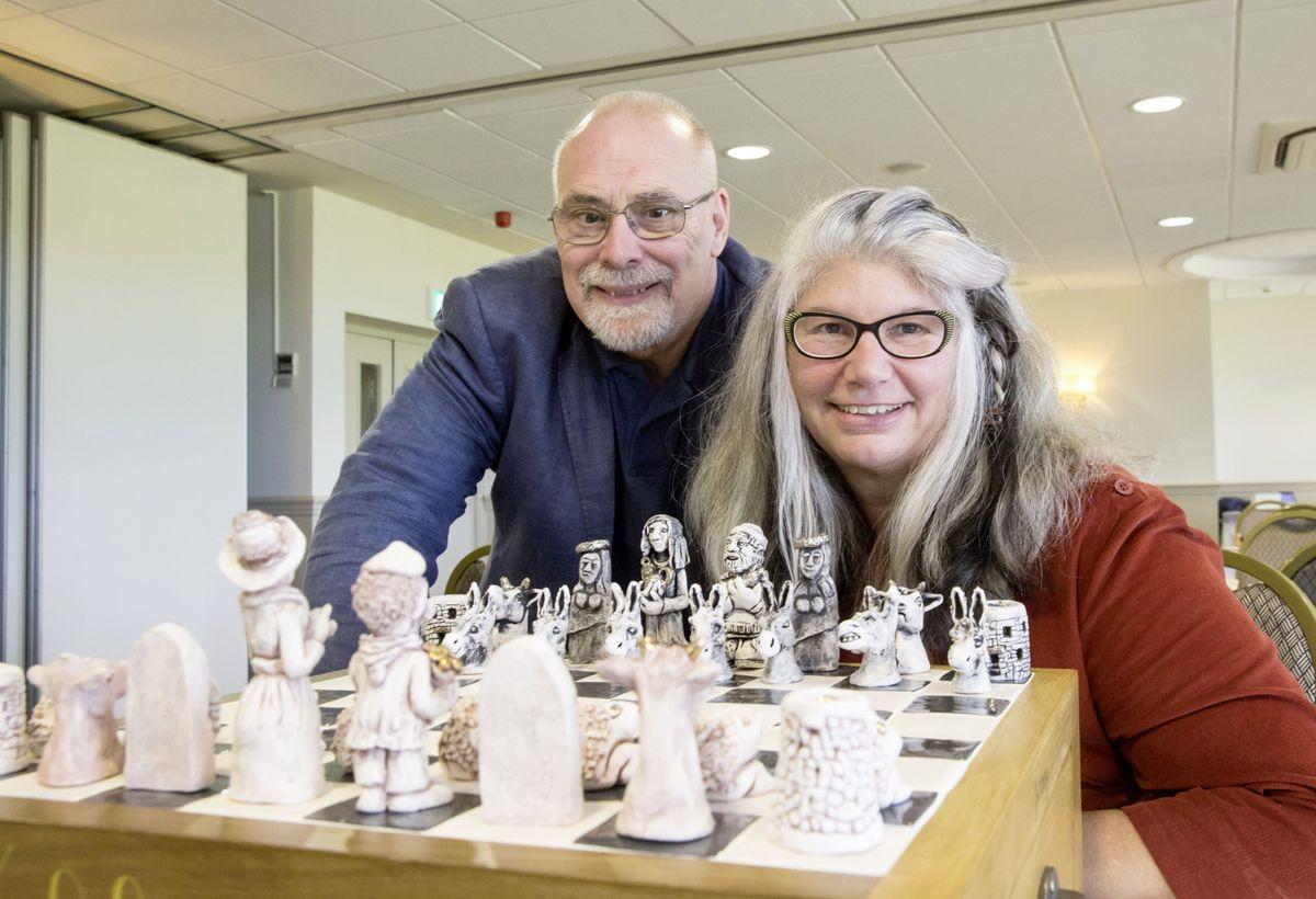 Yasmin Mariess with her handmade chess set, along with International Chess Festival organiser Peter Rowe. (26170772)
