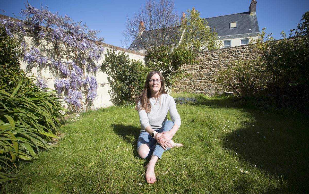 Madeleine Norman in her garden in Hauteville. She is concerned about the increasing use of plastic grass and is encouraging people to use the real thing for their lawn. (Picture by Adrian Miller, 29484396)