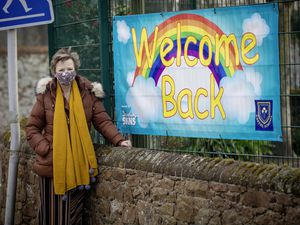A welcome back banner with a rainbow and head teacher Linda Paley were there to greet Castel Primary School pupils when they went back to school yesterday. (Picture by Peter Frankland, 29314016)