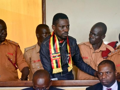 Ugandan pop star taken away by police after returning from US