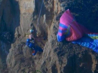 In Video: Coastguard saves paraglider who crashed into cliff