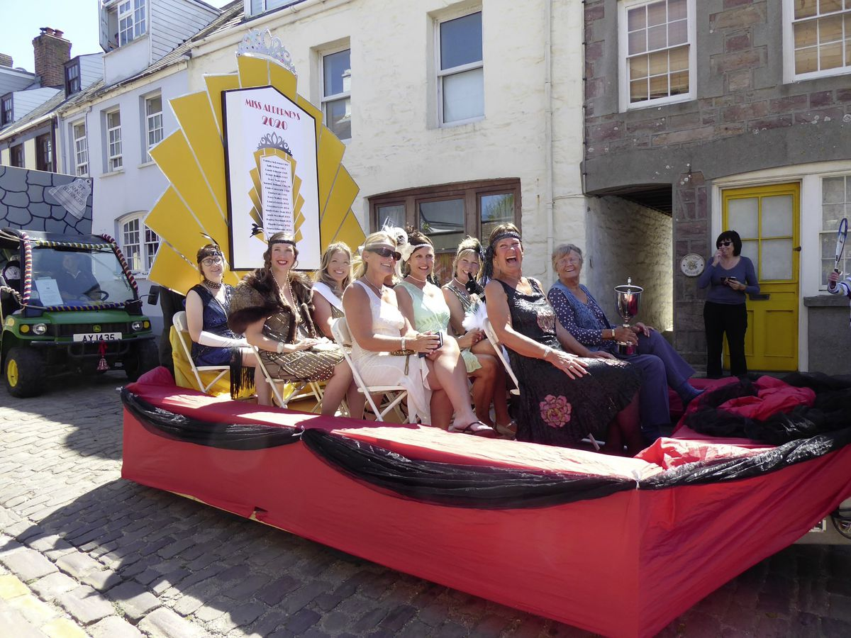 The Miss Alderney float with former winners taking part in the cavalcade. (Picture by Alex Flewitt)