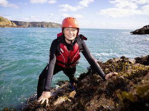 Picture By Peter Frankland. 02-10-19 Hannah Mackay is raising money for dementia charities by taking on challenges around the UK. Today she was coasteering with Outdoor Guernsey at Le Gouffre.. (25962195)