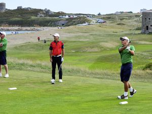 Seniors Golf Inter-Insular at L'Ancresse, Guernsey over-55s v Jersey O55s,1-2 September 2018. Mark Allez hits his tee shots on the 16th watched by opponent Trevor Gray and match referee Alan Mahy.Picture by Gareth Le Prevost. (22418810)
