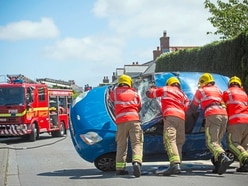 One car overturns in traffic lights collision