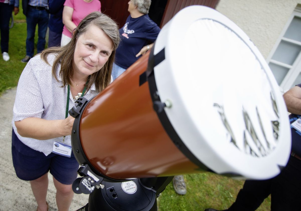 The weather failed to play ball for yesterday's partial eclipse of the sun, with fog and cloud making viewing difficult, to the disappointment of Elaine Mahy, the PR officer of La Societe's astronomical section, and others who gathered at its observatory. (Pictures by Peter Frankland, 29640979)