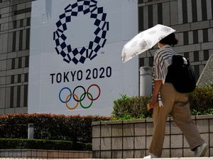 Tokyo virus cases hit six-month high two days before Games open