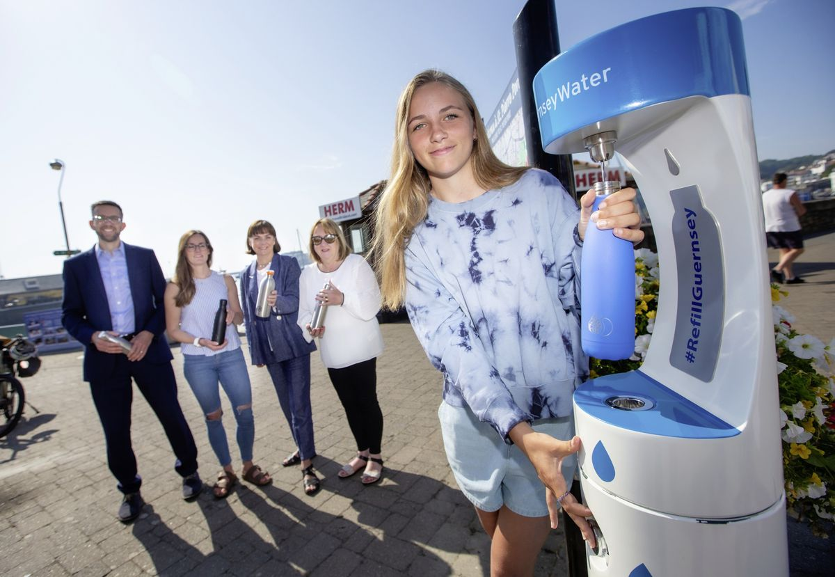 Three years after she put the idea of water refill stations to the authorities, Destiny Hollyer-Hil, 14, was the first to fill up at the first one by the Liberation monument. Behind her are representatives of the three organisations who made it happen, left to right, Steve Langlois, CEO of Guernsey Water, Madeleine Norman, of Plastic Free Guernsey, Tina Norman-Ross, from Guernsey Waste, and Margaret McGuinness, Guernsey Water's water quality risk manager. (Pictures by Peter Frankland, 29663911)