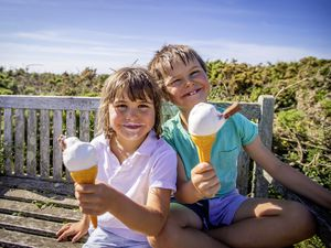 Edie Roffey, 5, and Arlo Roffey, 7, enjoying ice creams at the beach yesterday. (Picture by Sophie Rabey, 29656432)