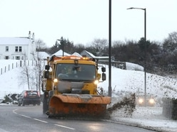 Heavy snow causes tricky rush hour conditions for motorists