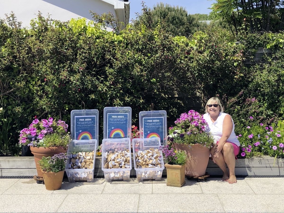 Guernsey Electricity business support team lead Diana Knight with some of the wildflower seeds which the company is giving away for islanders to plant at home to encourage pollinators. (Pictures supplied by Guernsey Electricity)