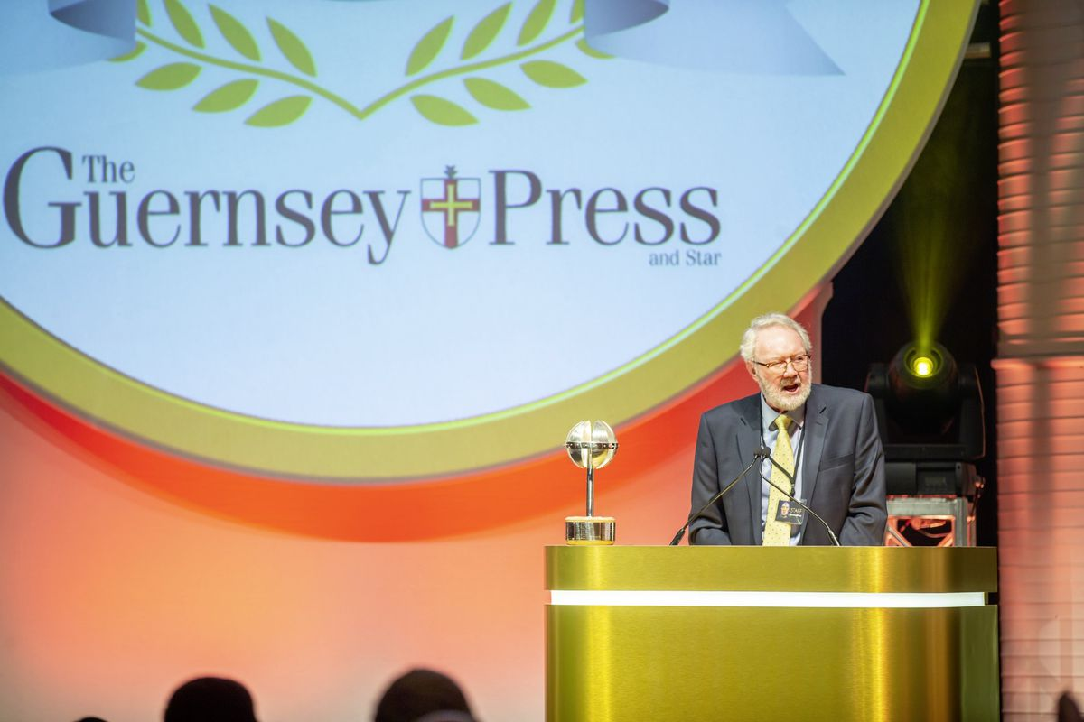 Guernsey Press chairman Terry Holder announces the Guernsey Press Ambassador award at the Pride of Guernsey event. It was presented to Dr Nicola Brink by His Excellency Lt Governor Sir Ian Corder. (Picture by Sophie Rabey, 28761695)