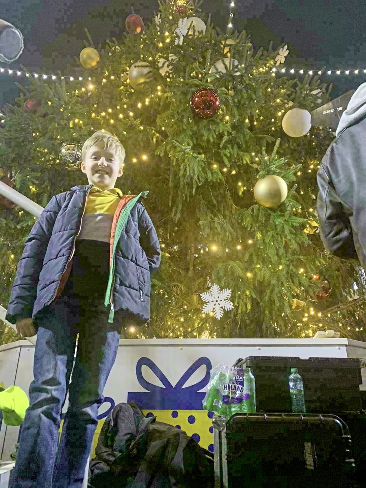 Aaron Loveridge, 8, with the Christmas tree in Market Square after he pushed the lever to turn all of the Christmas lights on in town. (28938017)