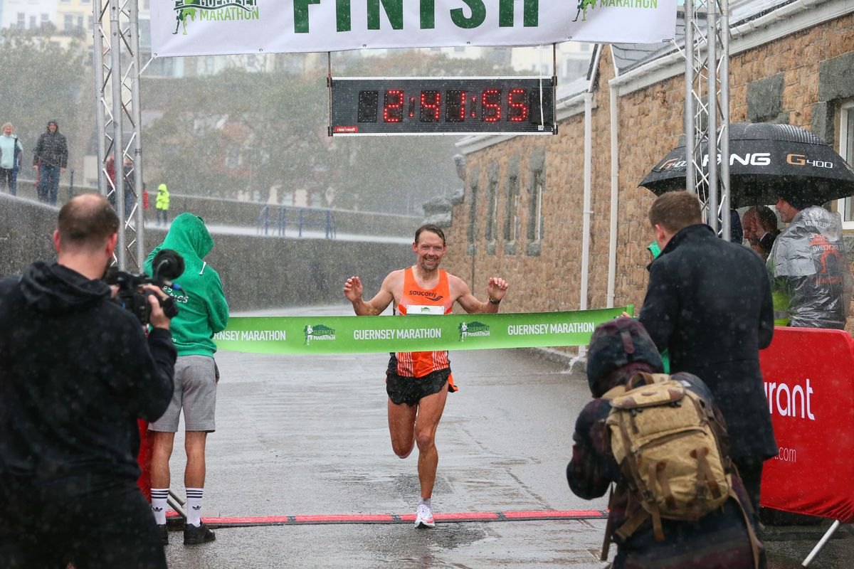 Richard Friedrich takes the tape at the finish line to win the 2020 Guernsey Marathon held last October. (Picture by Adrian Miller, 29257307)