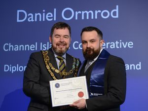 Daniel Ormrod of Argent Funeral Care receiving award of the Diploma of Funeral Arranging and Administration. (Image supplied by Argent Funeral Care)