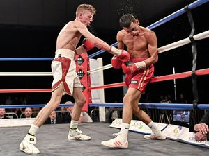 The path to glory: Brad Watson (left) on the attack in a thrilling English super-flyweight title fight against Loua Nassa. (Picture by Keith Turner)
