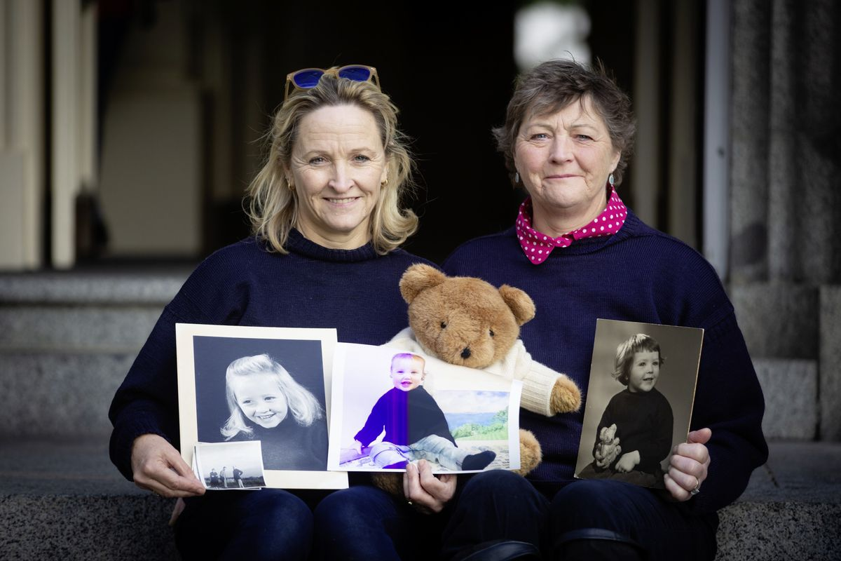 Sisters Alex Haining, left, and Julia White with pictures of themselves wearing guernsey jumpers when they were children. Alex is holding a picture of her grandfather wearing one in the 1950s, lower left. (Picture by Peter Frankland, 28930378)